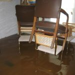 Immediately remove the submerged furniture from the water to a safe, dry area.