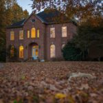 Fall-Season-Brick-Home-Lights-On