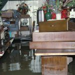 Remove all personal contents from the flooded basement and lay them flat in a dry area
