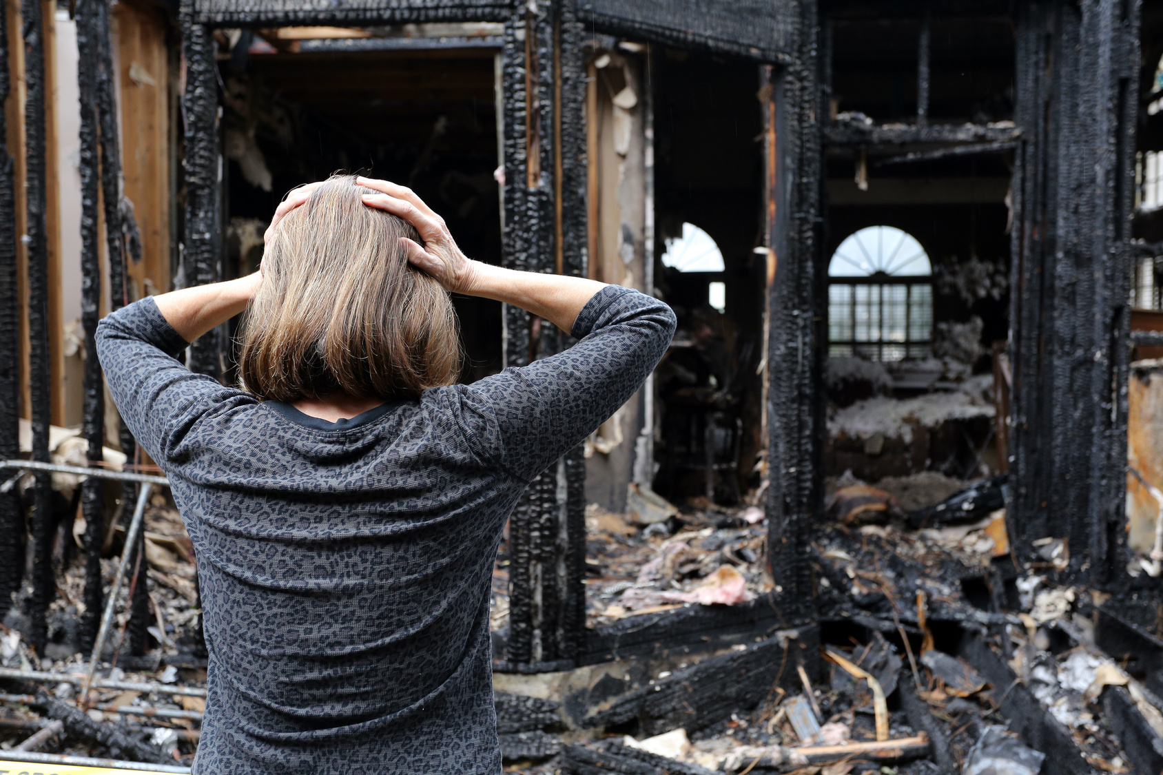 House-Fire-Damage-Woman-Stressed