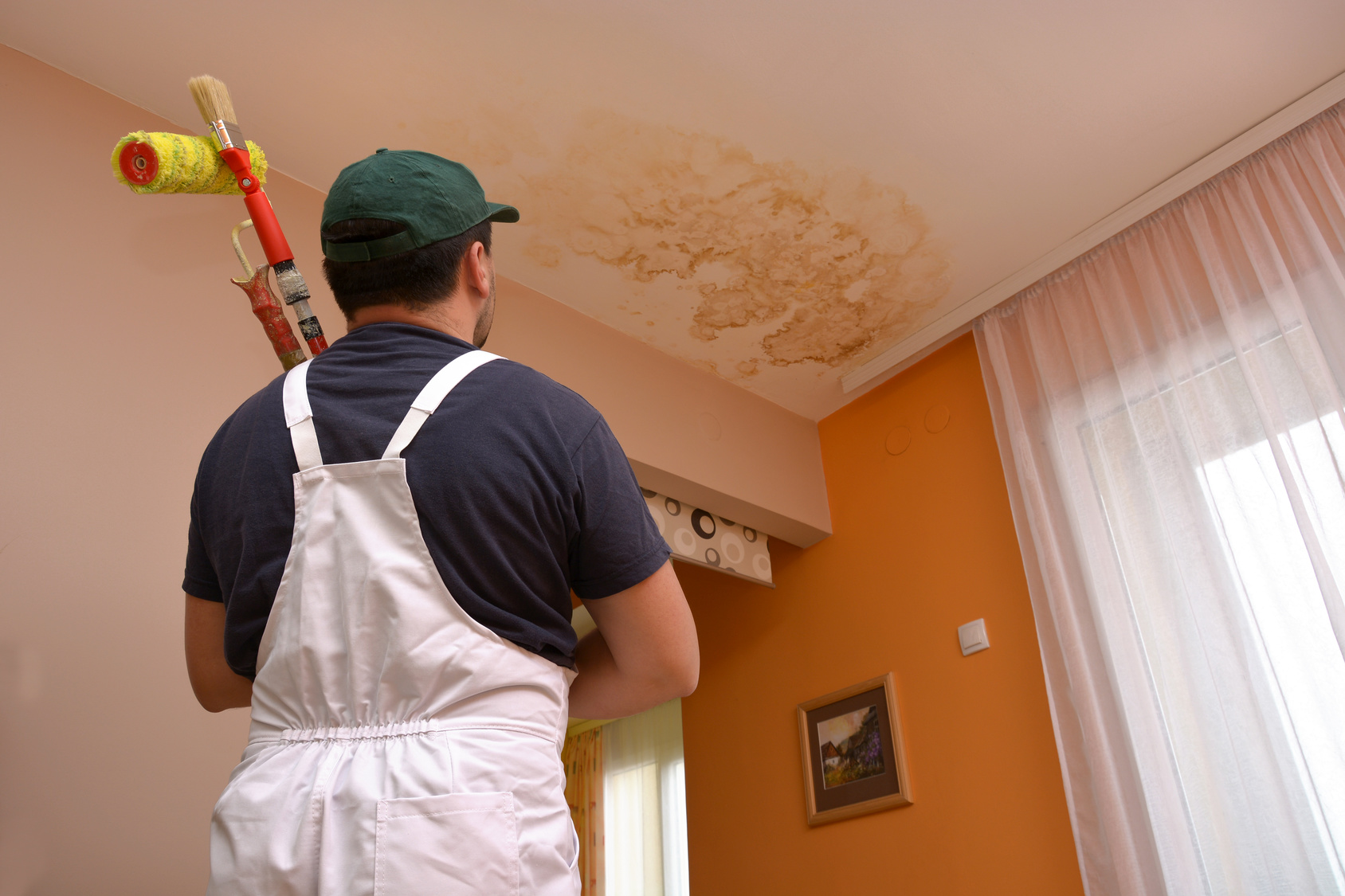 Painter-Staring-at-Water-Stain-on-Ceiling